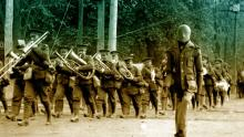 A screen shot of the mannequin-soldier trying to join a large group of marching soldiers